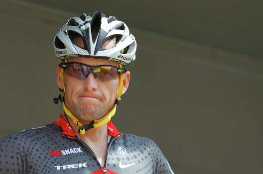 Lance Armstrong grimacing July 6, 2010 prior to the start of the third stage of the Tour de France cycling race in Wanze, Belgium.  (AP Photo/Christophe Ena) Photo: Christophe Ena, Associated Press / AP
