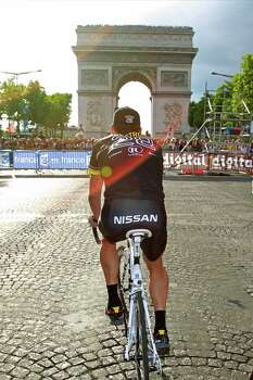 Lance Armstrong of the US rides towards the Arc de Triomphe during the parade after the 20th and last stage of the Tour de France cycling race over 102.5 kilometers (63.7 miles) with start in Longjumeau and finish in Paris, France, Sunday, July 25, 2010. (AP Photo/Bas Czerwinski) Photo: Bas Czerwinski, Associated Press / AP
