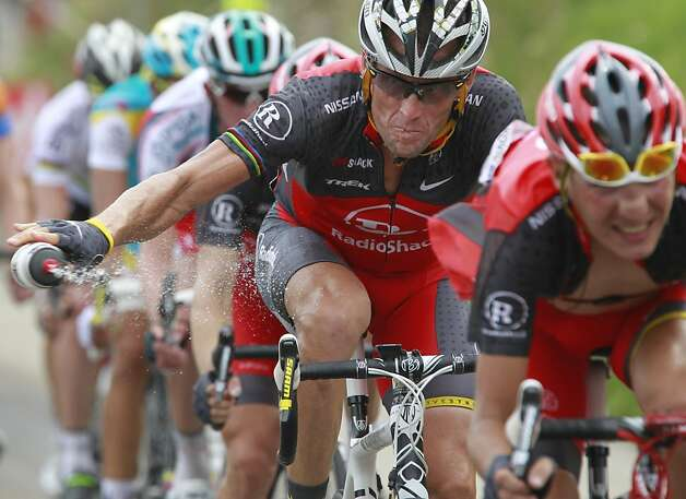 Lance Armstrong, shown competing during his last Tour de France in 2010, has denied accusations of doping for a decade, but reportedly will admit to it in a television interview. Photo: Bas Czerwinski, Associated Press