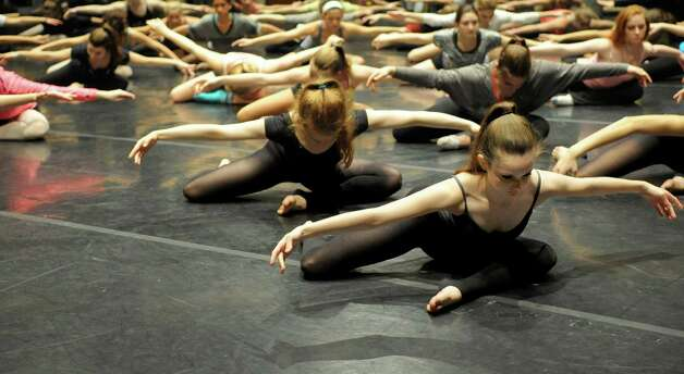 Dancers, including Emily Robertson, 14, front, participate in Saturday's intermediate level master class during DanceFest at the Palace Theatre in Stamford on January 12, 2013. Photo: Lindsay Perry / Stamford Advocate