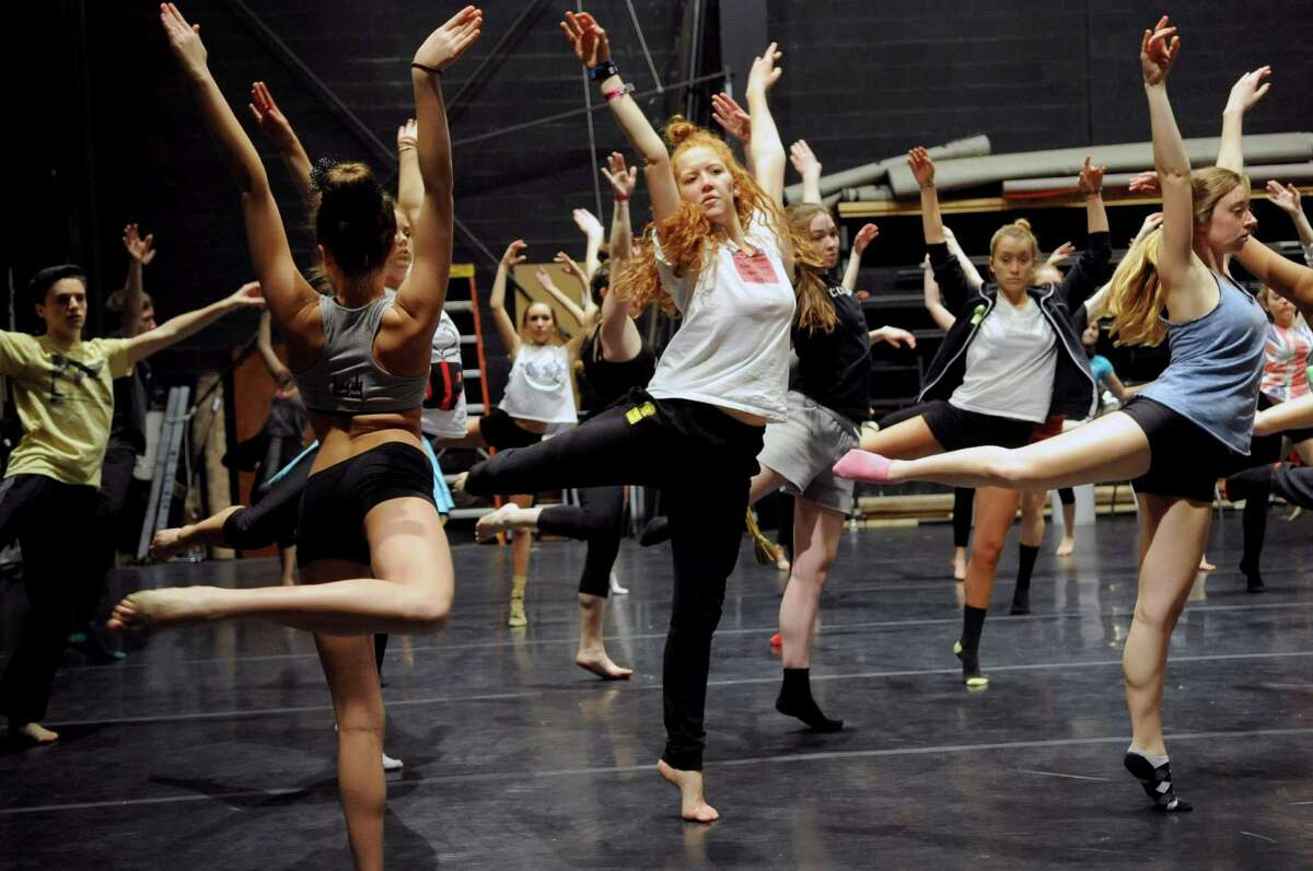 Dancers, including Emma Fichtner, 17, center, participate in Saturday's intermediate level master class during DanceFest at the Palace Theatre in Stamford on January 12, 2013.