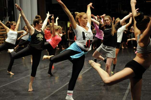 Dancers, including Abbie Fichtner, 18, participate in Saturday's intermediate level master class during DanceFest at the Palace Theatre in Stamford on January 12, 2013. Photo: Lindsay Perry / Stamford Advocate