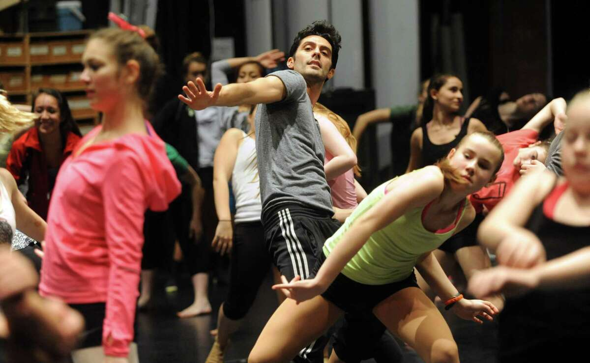 Instructor Brice Mousset is seen demonstrating a move through participating dance students during Saturday's intermediate level master class during DanceFest at the Palace Theatre in Stamford on January 12, 2013.