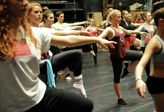 Dancers, including Kate Blasco, 16, center, participate in Saturday's intermediate level master class during DanceFest at the Palace Theatre in Stamford on January 12, 2013. Photo: Lindsay Perry / Stamford Advocate