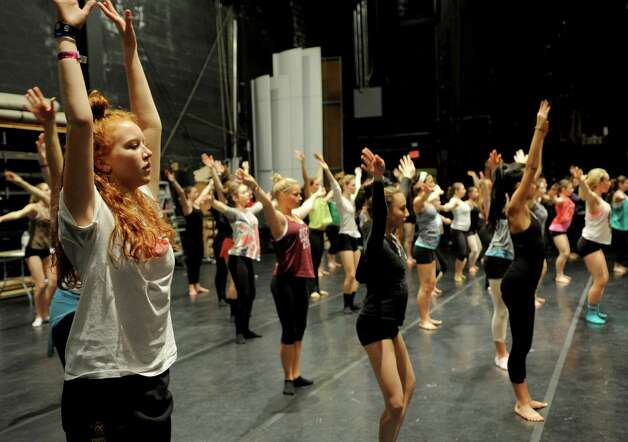 Dancers, including Emma Fichtner, 17, left, participate in Saturday's intermediate level master class during DanceFest at the Palace Theatre in Stamford on January 12, 2013. Photo: Lindsay Perry / Stamford Advocate