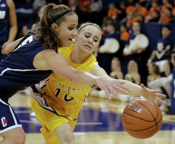 Connecticut's Caroline Doty, left, and Marquette's Brooklyn Pumroy chase down a loose ball in the first half of an NCAA college basketball game Saturday, Jan. 12, 2013, in Milwaukee. (AP Photo/Jeffrey Phelps) Photo: JEFFREY PHELPS, Associated Press / FR59249 AP