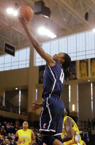 Connecticut's Brianna Banks puts up a shot against Marquette in the first half of an NCAA college basketball game Saturday, Jan. 12, 2013, in Milwaukee. (AP Photo/Jeffrey Phelps) Photo: Jeffrey Phelps, Associated Press / FR59249 AP