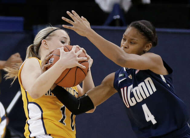 Connecticut's Moriah Jefferson(4) steals the ball from Marquette's Brooklyn Pumroy during the first half of an NCAA college basketball game Saturday, Jan. 12, 2013, in Milwaukee. (AP Photo/Jeffrey Phelps) Photo: Jeffrey Phelps, Associated Press / FR59249 AP