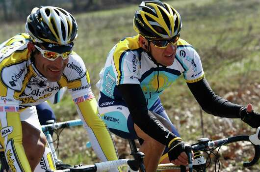 "FILE - This March 21, 2009 file photo shows Lance Armstrong, of the United States, beside fellow countryman George Hincapie, left, during the Milan-San Remo cycling classic in San Remo, Italy. The U.S. Anti-Doping Agency says 11 of Lance Armstrong's former teammates testified against him in its investigation of the cyclist, revealing ""the most sophisticated, professionalized and successful doping program that sport has ever seen."" (AP Photo/Alessandro Trovati) Photo: ALESSANDRO TROVATI, Associated Press / AP"
