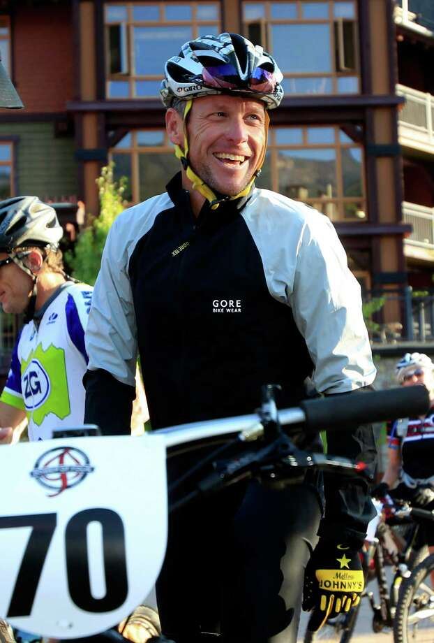 Lance Armstrong laughs while preparing to take part in the Power of Four mountain bicycle race at the starting line in Snowmass Village, Colo., early Saturday, Aug. 25, 2012. The race is the first public appearance for Armstrong since the U.S. Anti-Doping Association stripped him of his seven Tour de France championships and banned him for life from the sport.  (AP Photo/David Zalubowski) Photo: David Zalubowski, Associated Press / AP