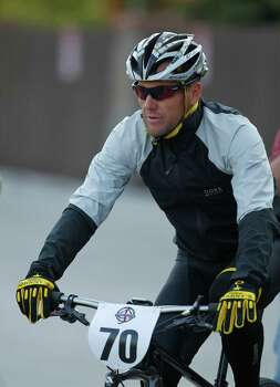 Lance Armstrong prepares to take part in the Power of Four mountain bicycle race at the starting line in Snowmass Village, Colo., early Saturday, Aug. 25, 2012. The race is the first public appearance for Armstrong since the U.S. Anti-Doping Association stripped him of his seven Tour de France championships and banned him for life from the sport.  (AP Photo/David Zalubowski) Photo: David Zalubowski, Associated Press / AP