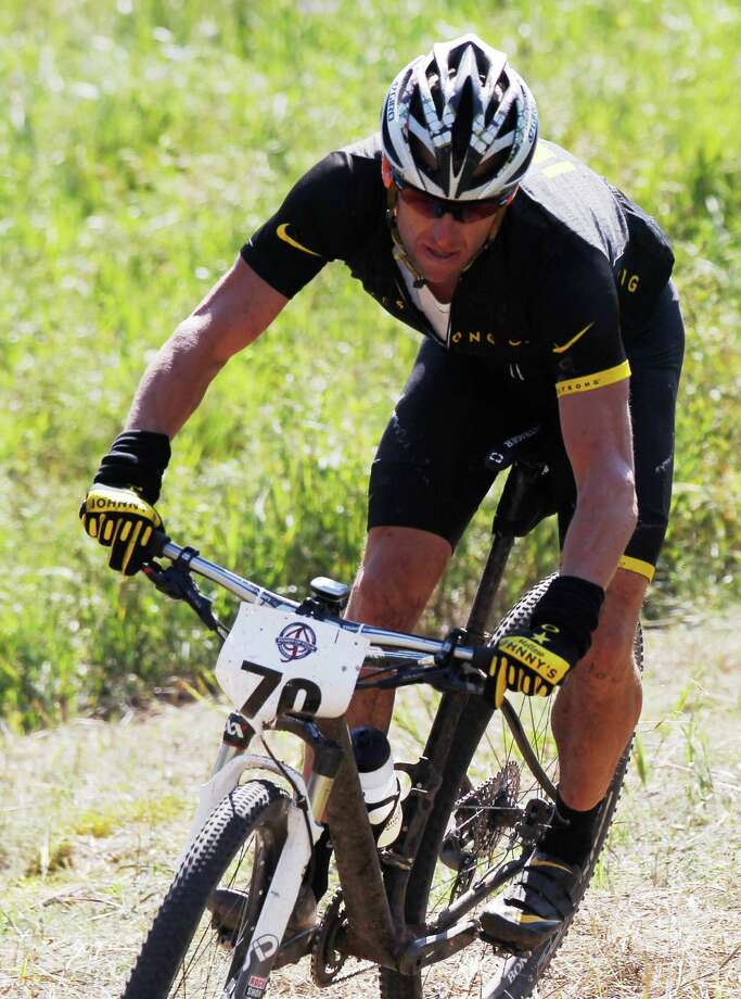 Lance Armstrong turns on his way to a second-place finish in the Power of Four mountain bicycle race at the base of Aspen Mountain in Aspen, Colo., on Saturday, Aug. 25, 2012. The race is the first public appearance for Armstrong since the U.S. Anti-Doping Association stripped him of his seven Tour de France championships and banned him for life from professional cycling. (AP Photo/David Zalubowski) Photo: David Zalubowski, Associated Press / AP