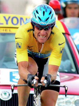 Overall leader Lance Armstrong, of Austin, Texas, crosses the finish line July 23, 2005 to win the 20th stage of the Tour de France cycling race, a 55.5-kilometer (34.5-mile) individual time trial looping around north of Saint-Etienne, central France.  (AP Photo/Alessandro Trovati) Photo: Alessandro Trovati, Associated Press / AP2005