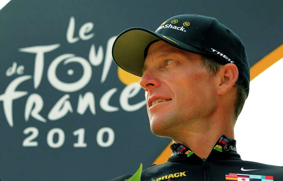 Lance Armstrong looks back on the podium July 25, 2010 after the 20th and last stage of the Tour de France cycling race in Paris, France.   (AP Photo/Bas Czerwinski) Photo: Bas Czerwinski, Associated Press / AP2012