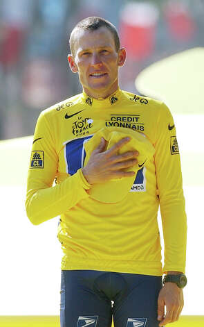 Lance Armstrong holds his hand on his chest as he listens to national anthems July 25, 2004 after winning his sixth straight Tour de France race, in Paris.   (AP Photo/Christophe Ena) Photo: CHRISTOPHE ENA, Associated Press / AP