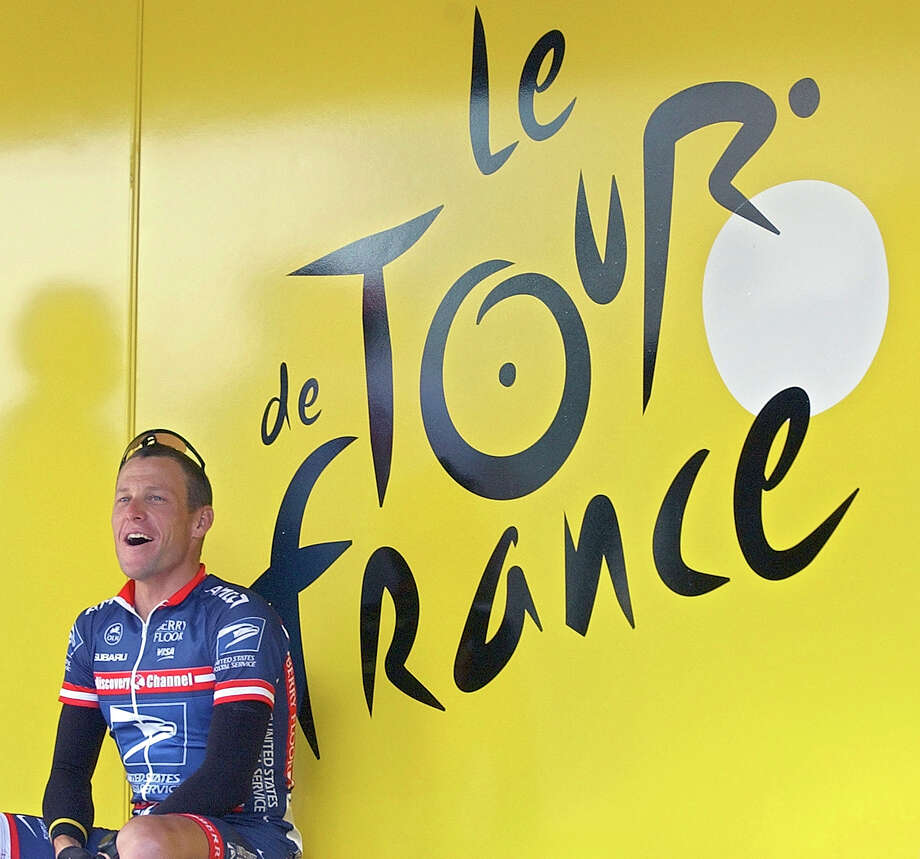 """FILE - In this July 5, 2004, file photo, US Postal Service team leader and then a five-time Tour de France winner Lance Armstrong, of Austin, Texas, sits by the registration bus prior to the second stage of the 91st Tour de France cycling race between Charleroi and Namur, Belgium. The U.S. Anti-Doping Agency is bringing doping charges against the seven-time Tour de France winner, questioning how he achieved those famous cycling victories.  Armstrong, who retired from cycling last year, could face a lifetime ban from the sport if he is found to have used performance-enhancing drugs. He maintained his innocence, saying: """"I have never doped.""""  (AP Photo/Peter Dejong, File) Photo: Peter Dejong, Associated Press / AP2004"""