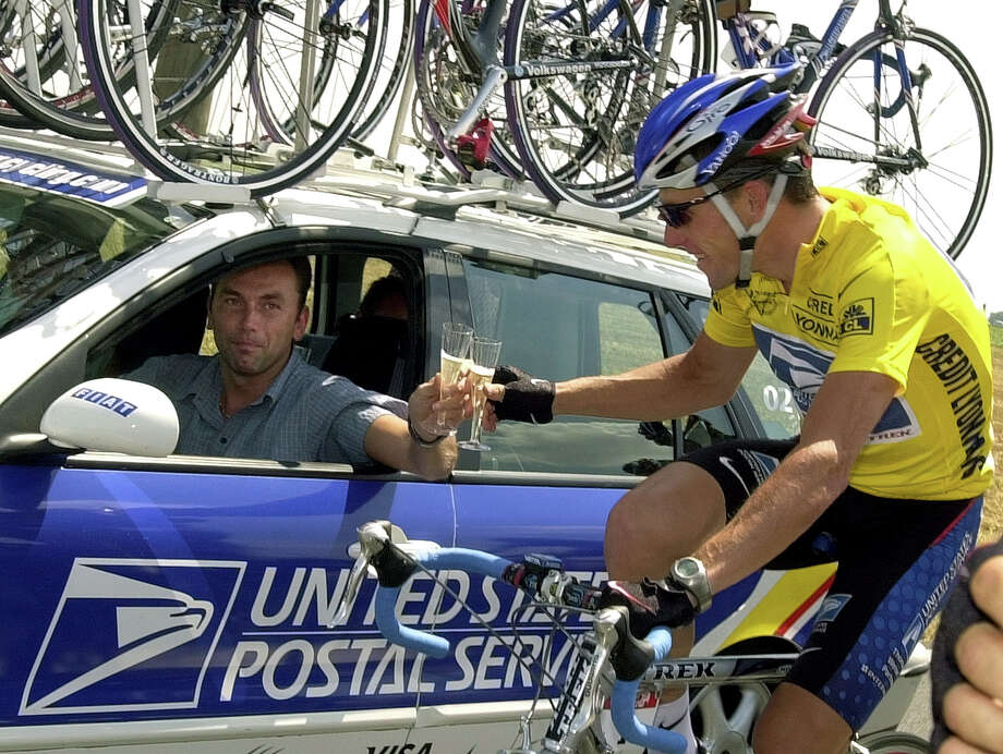 "FILE - In this July 28, 2002, file photo, overall leader Lance Armstrong of Austin, Texas, toast team director Johan Bruyneel with a glass of champagne during the final stage of the Tour de France cycling race between Melun and Paris, France. The U.S. Anti-Doping Agency is bringing doping charges against the seven-time Tour de France winner, questioning how he achieved those famous cycling victories.  Armstrong, who retired from cycling last year, could face a lifetime ban from the sport if he is found to have used performance-enhancing drugs. He maintained his innocence, saying: ""I have never doped.""  (AP Photo/Peter Dejong, File) Photo: PETER DEJONG, Associated Press / AP2002"