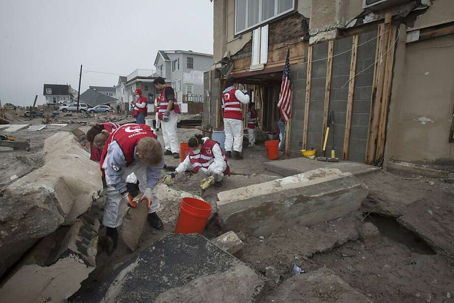 Volunteers continue the cleanup of debris outside a house in Queens, N.Y., hit by Superstorm Sandy. Photo: Lee Celano, Getty Images