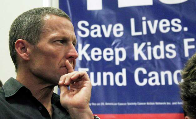 Cycling legend and cancer survivor Lance Armstrong attends a rally at a news conference at Children's Hospital in Los Angeles on May 11, 2012 in favor of Proposition 29, a measure on the June 2012 California primary election ballot that would add a $1-per-pack tax on cigarettes.  (AP Photo/Reed Saxon) Photo: Reed Saxon, Associated Press / AP2012