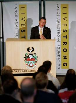 Lance Armstrong speaking during the launch of the Livestrong Global Cancer campaign  Royal Adelaide Hospital in Adelaide, Australia, Jan. 19, 2009. Armstrong said Wednesday, Oct. 17, 2012, he is stepping down as chairman of his Livestrong cancer-fighting charity so the group can focus on its mission instead of its founder's problems.   (AP Photo/Aman Sharma) Photo: Aman Sharma, Associated Press / AP