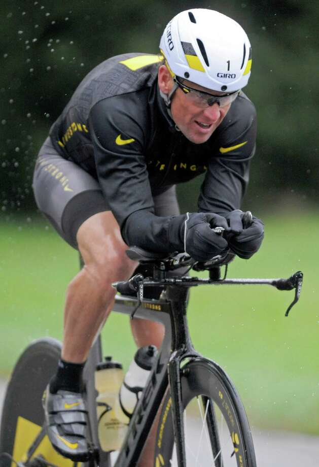 Lance Armstrong competes in the Rev3 Half Full triathalon Oct. 7, 2012 in Ellicott City, Md. Armstrong joined other cancer survivors in the event which raised funds for the Ulman Cancer Fund for Young Adults.  (AP Photo/Steve Ruark) Photo: Steve Ruark, Associated Press / FR96543 AP