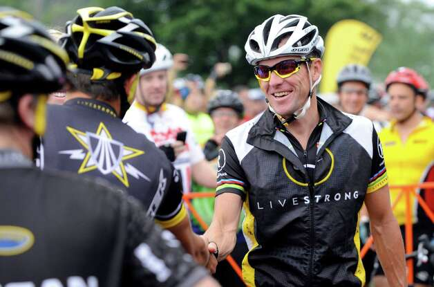 Lance Armstrong greets fellow riders Aug. 22, 2010 prior to the start of his Livestrong Challenge 10K ride for cancer in Blue Bell, Pa.  (AP Photo/Bradley C Bower) Photo: Bradley C Bower, Associated Press / FR37962 AP