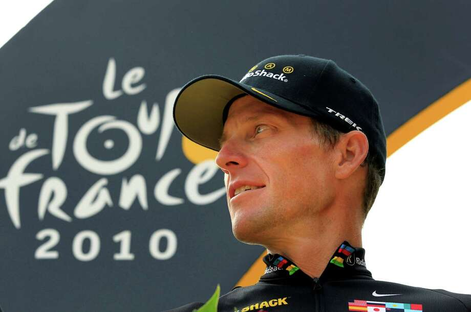 Lance Armstrong stands on the podium July 25, 2010 after the 20th and last stage of the Tour de France cycling race in Paris, France.    (AP Photo/Bas Czerwinski) Photo: Bas Czerwinski, Associated Press / AP