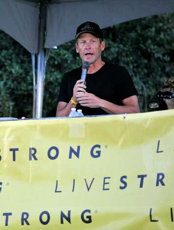 Lance Armstrong speaks at the Livestrong Challenge Austin bike ride Sunday, Oct. 21, 2012, in Austin, Texas.  Lance Armstrong greeted about 4,300 cyclists at his Livestrong charity's fund-raising bike ride, then retreated into privacy as cycling officials prepare to announce if they will appeal his lifetime ban and loss of seven Tour de France titles ordered by the U.S. Anti-Doping Agency.(AP Photo/Michael Thomas) Photo: Michael Thomas, Associated Press / FR65778 AP