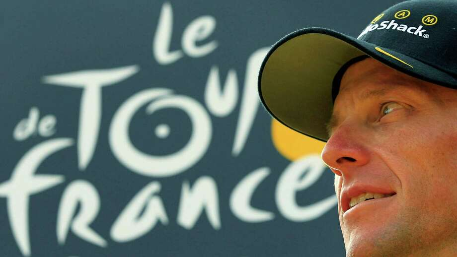 Seven-time Tour de France champion Lance Armstrong looking back on the podium July 25, 2010 after the 20th and last stage of the Tour de France cycling race in Paris, France.  (AP Photo/Bas Czerwinski) Photo: Bas Czerwinski, Associated Press / AP