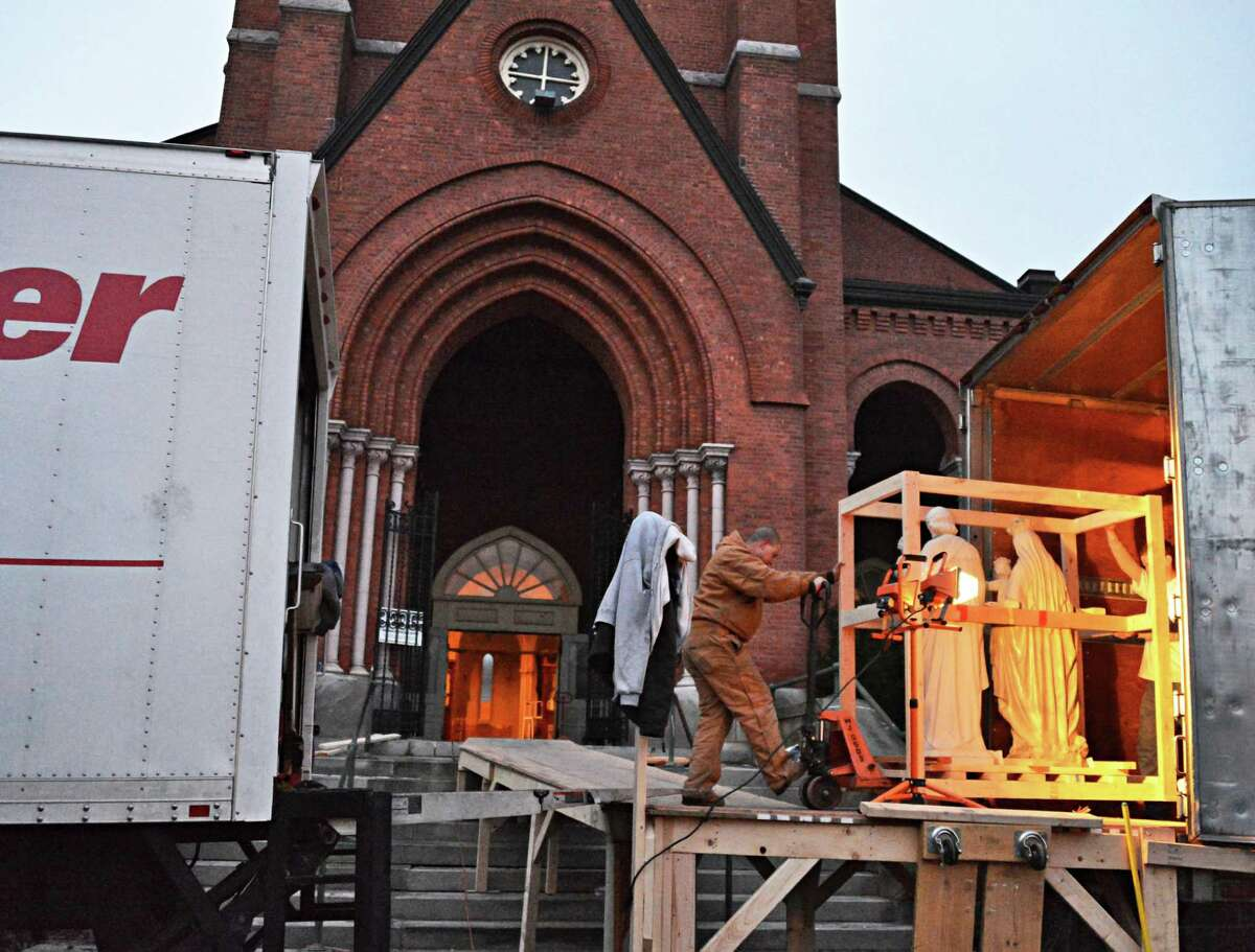 A crew from King Richard's Liturgical Design and Contracting of Atlanta remove statuary from the former St. Patrict's Catholic Church in Watervliet Saturday Jan. 12, 2013. (John Carl D'Annibale / Times Union)
