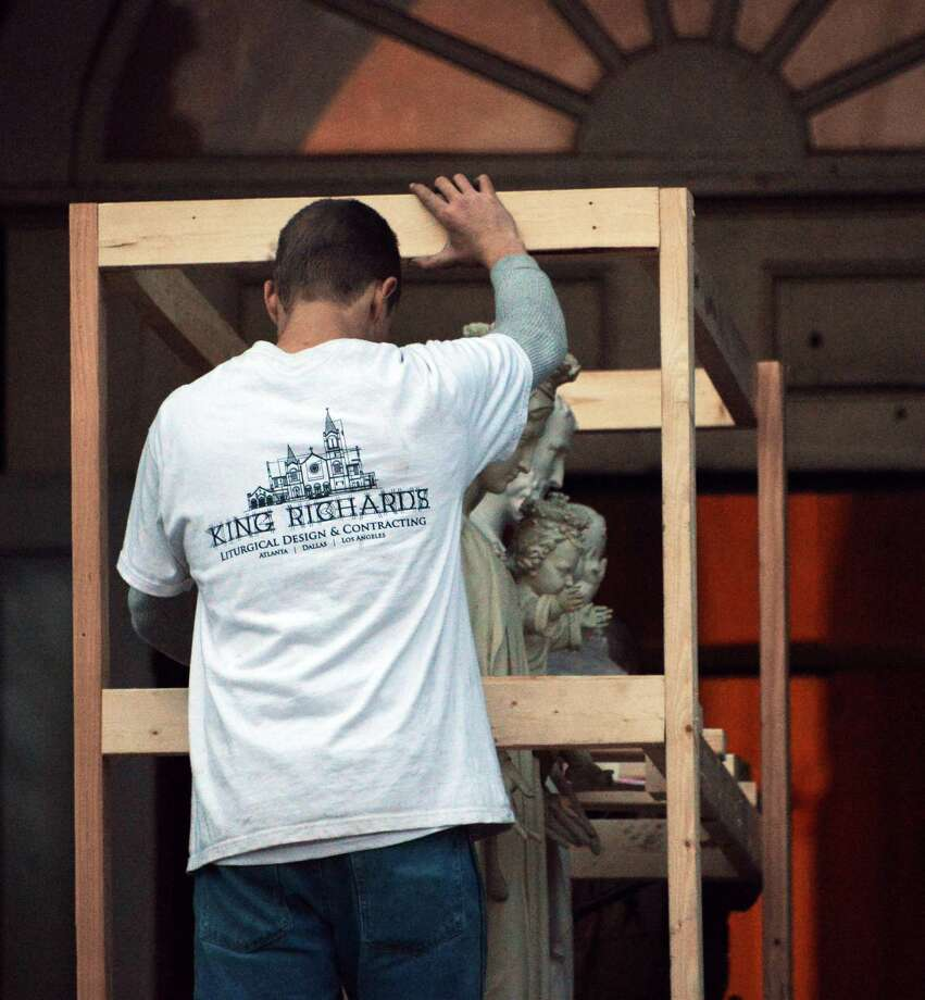 A crew from King Richard's Liturgical Design and Contracting of Atlanta remove statuary from the former St. Patrict's Catholic Church in Watervliet Saturday Jan. 12, 2013.  (John Carl D'Annibale / Times Union) Photo: John Carl D'Annibale