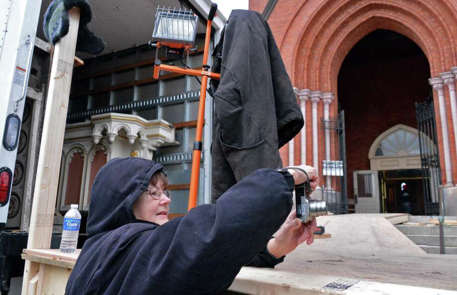 Ruth Clements of Wynantskill photographs  pieces from  from the former St. Patricks Catholic Church in Wtervliet being removed by King Richard's Liturgical Design and Contracting of Atlanta Saturday Jan. 12, 2013.  (John Carl D'Annibale / Times Union) Photo: John Carl D'Annibale