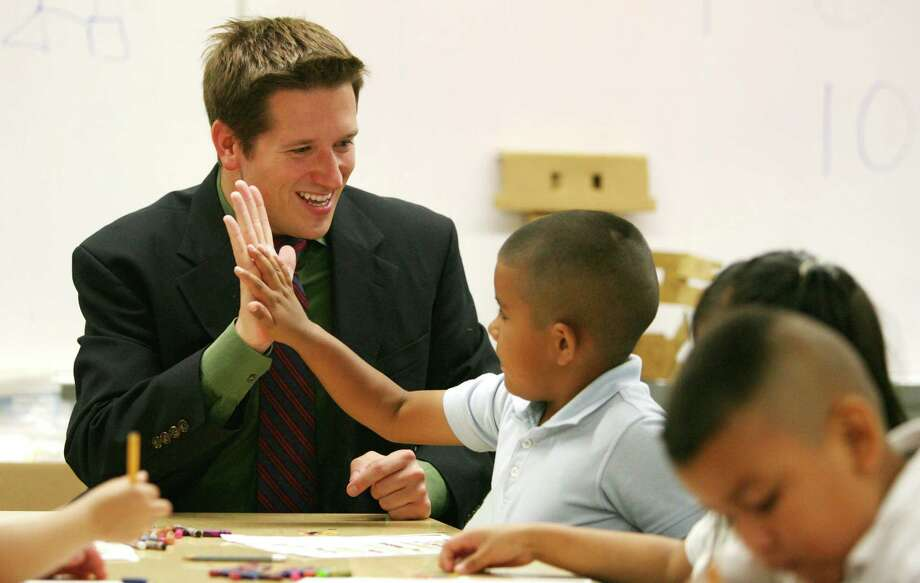 Jarrett Reid Whitaker, shown interacting with some pre-K students in 2008, was principal at Port Houston Elementary School. Now 32, he leads the Center for Digital Learning and Scholarship at Rice University. Photo: Billy Smith II, Staff / Houston Chronicle