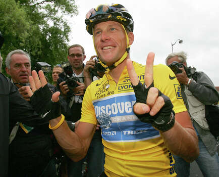 Lance Armstrong signals seven for his seventh straight win in the Tour de France cycling race July 24, 2005, at the start of the 21st and final stage of the race between Corbeil-Essonnes, south of Paris, and the French capital.  (AP Photo/Alessandro Trovati) Photo: ALESSANDRO TROVATI, Associated Press / AP