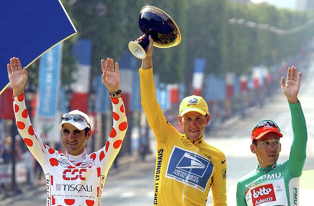Lance Armstrong, center, waves from the podium July 28, 2002 as he holds the winner's trophy, along with best sprinter Robbie McEwen, of Australia, right, and best climber Laurent Jalabert, of France, after the 20th and final stage of the Tour de France cycling race between Melun and Paris. (AP Photo/Peter Dejong) Photo: PETER DEJONG, Associated Press / AP