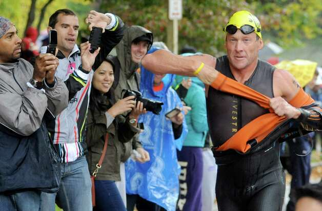 Lance Armstrong competes in the Rev3 Half Full Triathalon Sunday, Oct. 7, 2012 in Ellicott City, Md. Armstrong joined other cancer survivors in the event which raised funds for the Ulman Cancer Fund for Young Adults. (AP Photo/Steve Ruark) Photo: Steve Ruark, Associated Press / FR96543 AP