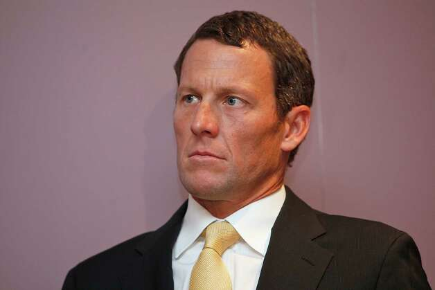 Lance Armstrong sits during a news conference Feb. 28, 2011 at the Cedars-Sinai Hospital in Los Angeles.    (AP Photo/Damian Dovarganes) Photo: Damian Dovarganes, Associated Press / AP