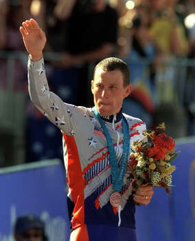 U.S. cyclist Lance Armstrong waving after receiving the bronze medal Sept. 30, 2000 in the men's individual time trials at the Summer Olympics in Sydney, Australia.  (AP Photo/Ricardo Mazalan) Photo: RICARDO MAZALAN, Associated Press / AP
