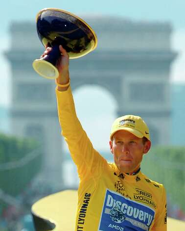 Lance Armstrong holds the winner's trophy July 24, 2005 after claiming his seventh straight Tour de France cycling race during ceremonies on the Champs-Elysees avenue in Paris after the 21st and final stage of the race between Corbeil-Essonnes, south of Paris, and the French capital.    (AP Photo/Bernard Papon, Pool) Photo: Bernard Papon, Associated Press / Pool L'Equipe