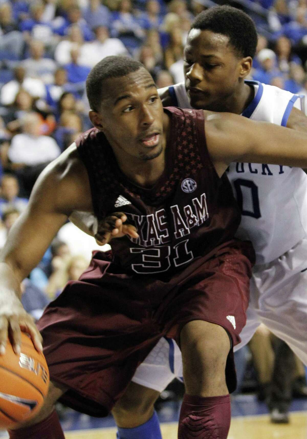 Texas A&M's Elston Turner, left, is pressured by Kentucky's Archie Goodwin during the second half of an NCAA college basketball game at Rupp Arena in Lexington, Ky., Saturday, Jan. 12, 2013. Texas A&M defeated Kentucky 83-71. (AP Photo/James Crisp)