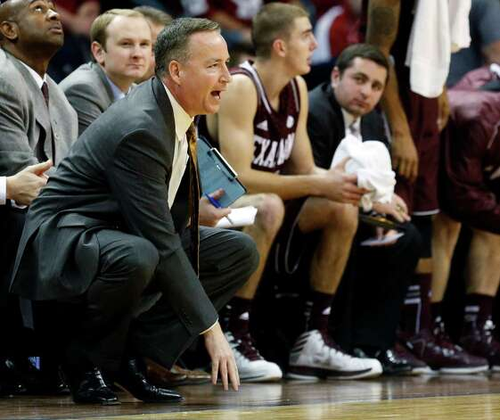 Texas A&M head coach Billy Kennedy, left, shouts to his team during the first half of an NCAA college basketball game against Oklahoma in the All College Classic tournament in Oklahoma City, Saturday, Dec. 15, 2012. Oklahoma won 64-54. (AP Photo/Sue Ogrocki) Photo: Sue Ogrocki, Associated Press / AP