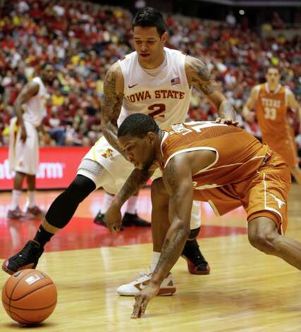 Texas guard Julien Lewis, right, loses the ball in front of Iowa State guard Chris Babb (2) during the second half of an NCAA college basketball game, Saturday, Jan. 12, 2013, in Ames, Iowa. Iowa State won 82-62. (AP Photo/Charlie Neibergall) Photo: Charlie Neibergall, Associated Press / AP