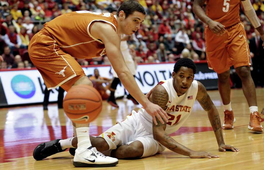 Iowa State guard Will Clyburn, right, loses the ball in front of Texas forward Ioannis Papapetrou during the first half of an NCAA college basketball game, Saturday, Jan. 12, 2013, in Ames, Iowa. Iowa State won 82-62. (AP Photo/Charlie Neibergall) Photo: Charlie Neibergall, Associated Press / AP
