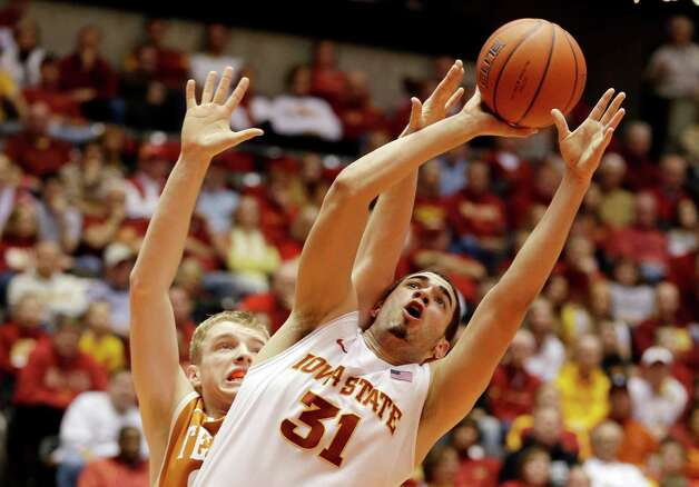 Iowa State forward Georges Niang (31) drives to the basket past Texas forward Connor Lammert, left, during the first half of an NCAA college basketball game, Saturday, Jan. 12, 2013, in Ames, Iowa. (AP Photo/Charlie Neibergall) Photo: Charlie Neibergall, Associated Press / AP