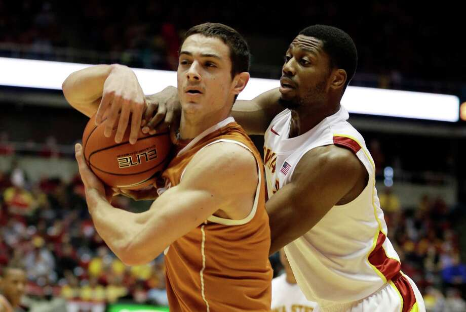 Iowa State forward Melvin Ejim, right, tries to steal the ball from Texas forward Ioannis Papapetrou during the first half of an NCAA college basketball game, Saturday, Jan. 12, 2013, in Ames, Iowa. (AP Photo/Charlie Neibergall) Photo: Charlie Neibergall, Associated Press / AP