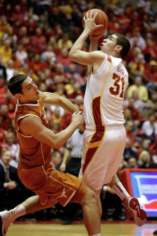 Iowa State forward Georges Niang, right, shoots over Texas forward Ioannis Papapetrou during the first half of an NCAA college basketball game, Saturday, Jan. 12, 2013, in Ames, Iowa. (AP Photo/Charlie Neibergall) Photo: Charlie Neibergall, Associated Press / AP
