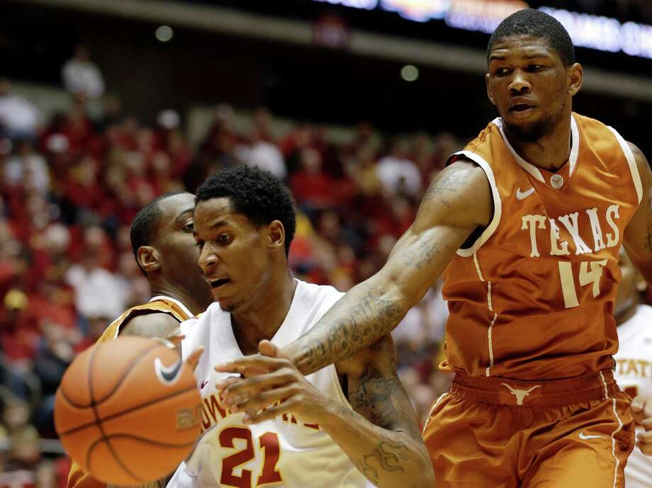 Iowa State guard Will Clyburn, left, fights for a loose ball with Texas guard Julien Lewis, right, during the first half of an NCAA college basketball game, Saturday, Jan. 12, 2013, in Ames, Iowa. (AP Photo/Charlie Neibergall) Photo: Charlie Neibergall, Associated Press / AP
