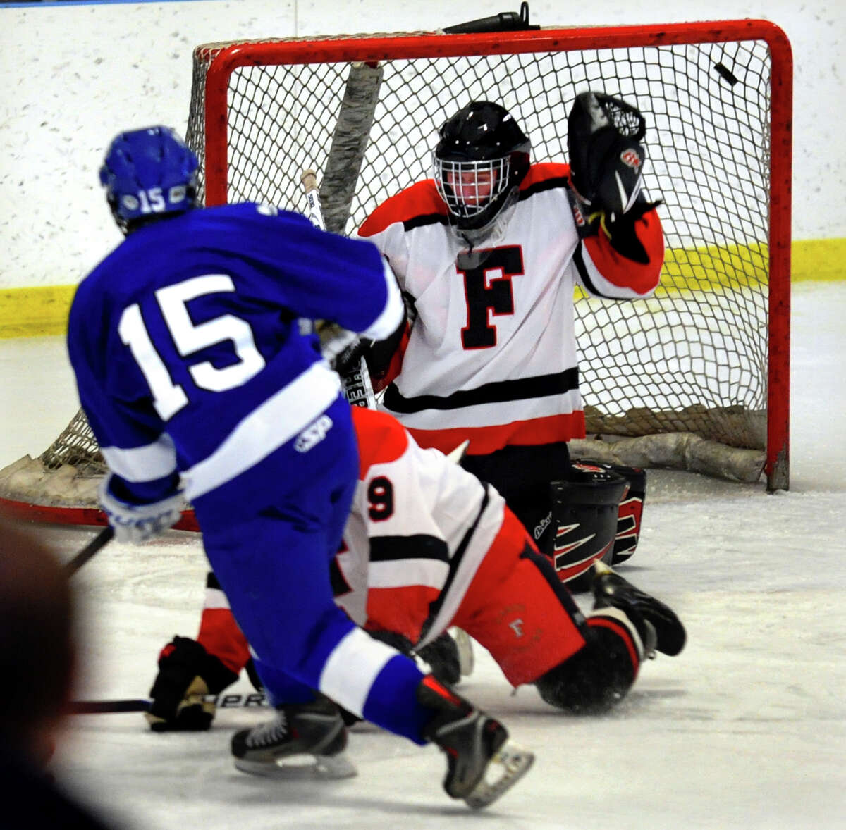 Fairfield Warde/Ludlowe goalie #1 Connor Frawley fails to stop a shot by Darien's #15 Craig Miller, during boys hockey action at the Wonderland of Ice in Bridgeport, Conn. on Saturday January 12, 2013.