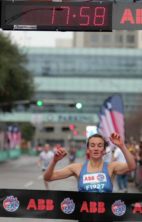 Annika Braun crosses the finish line to win the women's division of the ABB 5K race with an official time of 17:57 during the Houston Marathon race weekend Saturday, Jan. 12, 2013, in Houston. Photo: James Nielsen, Chronicle / © Houston Chronicle 2013