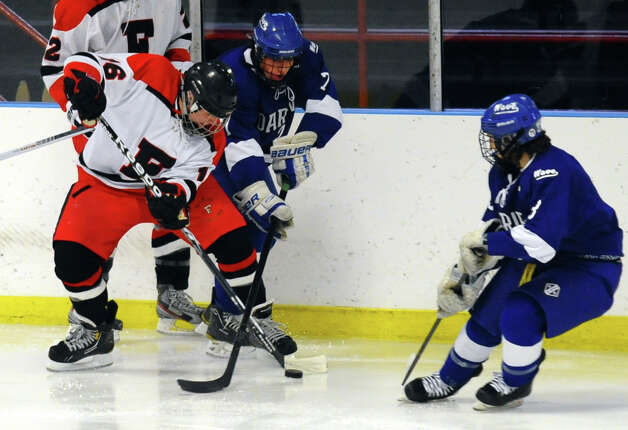 Fairfield Warde/Ludlowe's #16 Matthew Larouche and Darien's #7 Jack Knowlton scramble for the puck, during boys hockey action at the Wonderland of Ice in Bridgeport, Conn. on Saturday January 12, 2013. Photo: Christian Abraham / Connecticut Post